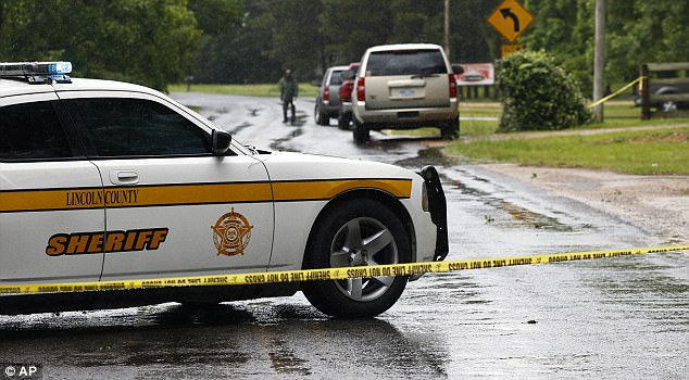 A Lincoln County Sheriff's vehicle and evidence tape block a street in Brookhaven, Mississippi