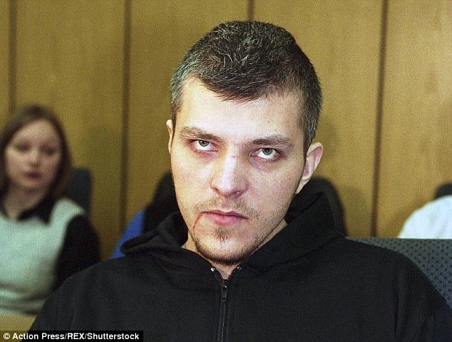 Ruda, pictured in 2002,filed his teeth to razor sharpness to make himself look like a vampire