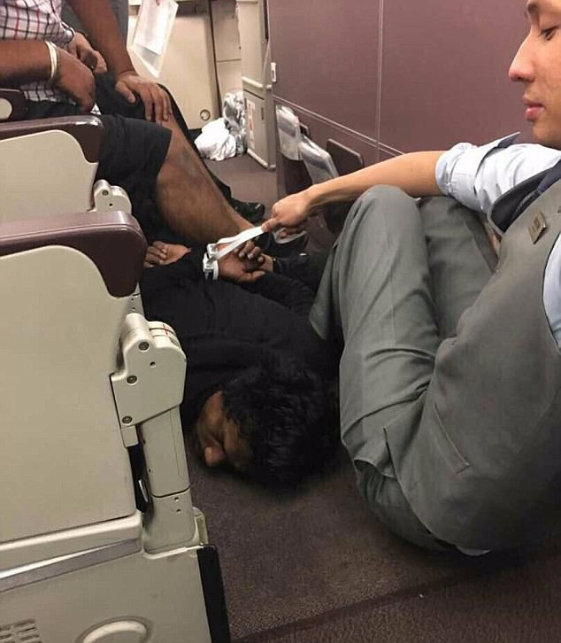 Images of the terrifying moment the attacker was subdued by passengers onboard the flight have been shared to social media. Having been tackled to the floor, photos appear to show a Malaysia Airlines flight attendant placing makeshift keeping him pressed to the ground