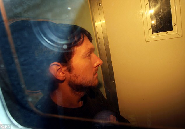 Forrest is seen in a prison van as he arrives at Eastbourne Magistrates' Court in October 2012