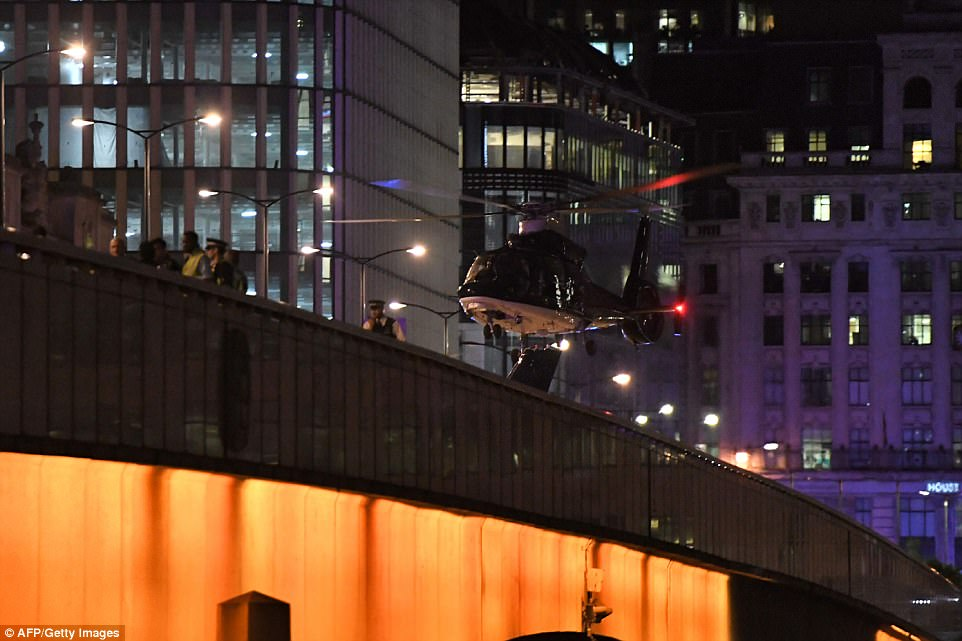 A helicopter, believed to be SAS, was seen at London Bridge after being flown in from the Hereford headquarters to hunt for the deadly terrorists
