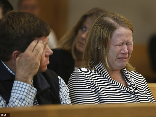 Roy family members react when crime-scene photos are projected during the trial of Michelle Carter, Tuesday,  in Taunton