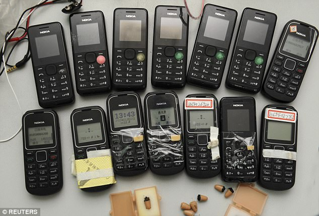 Mobile devices and receivers confiscated during past exams were also shown