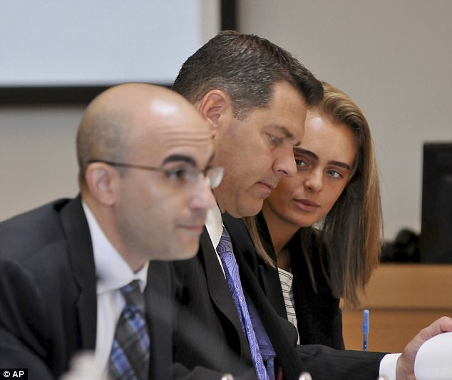 Defendant Michelle Carter, right, confers with her lawyer Joe Cataldo, center, as second defense attorney Cory Madera listens to testimonies