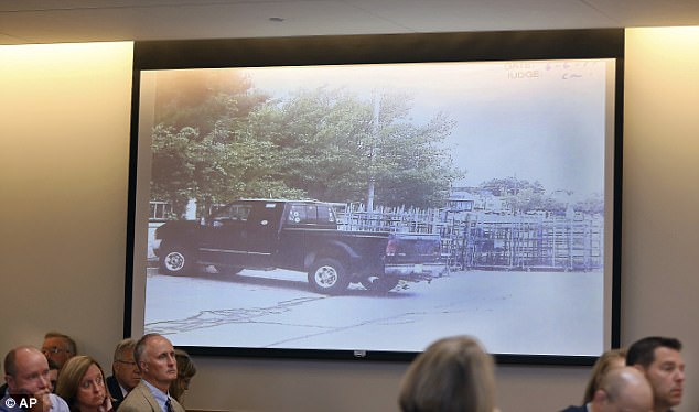 A photograph of the truck, in which Conrad Roy III killed himself, is projected during testimony in the trial