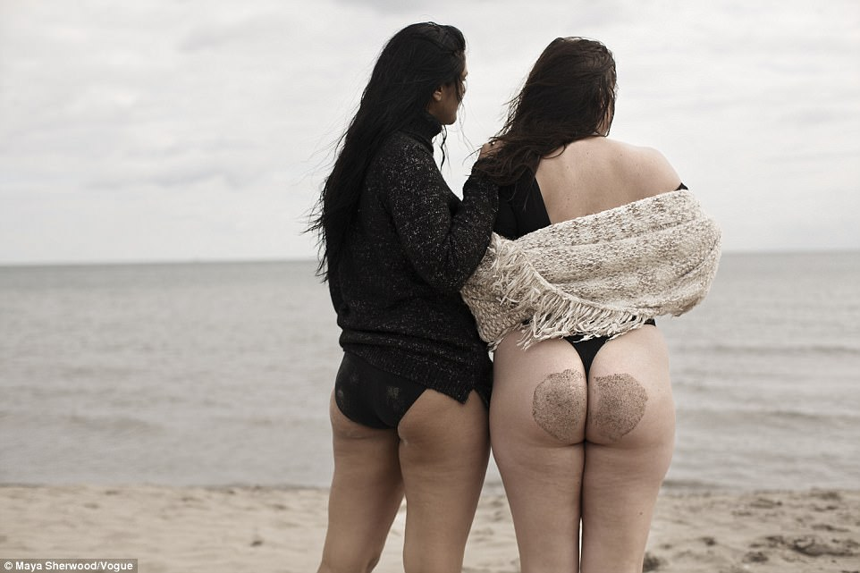 Tia, a UK size 12/14 who has walked the runway for designers including Lesley Hampton, can be seen posing in a series of stripped-back shots wearing nothing but a skimpy black swimsuit and a loose-fitting shirt alongside Karyn (right)