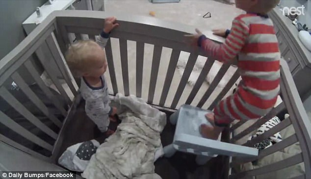 When the chair lands inside the crib, Finn's older brother demonstrates how to climb onto it (right) and then over the railings