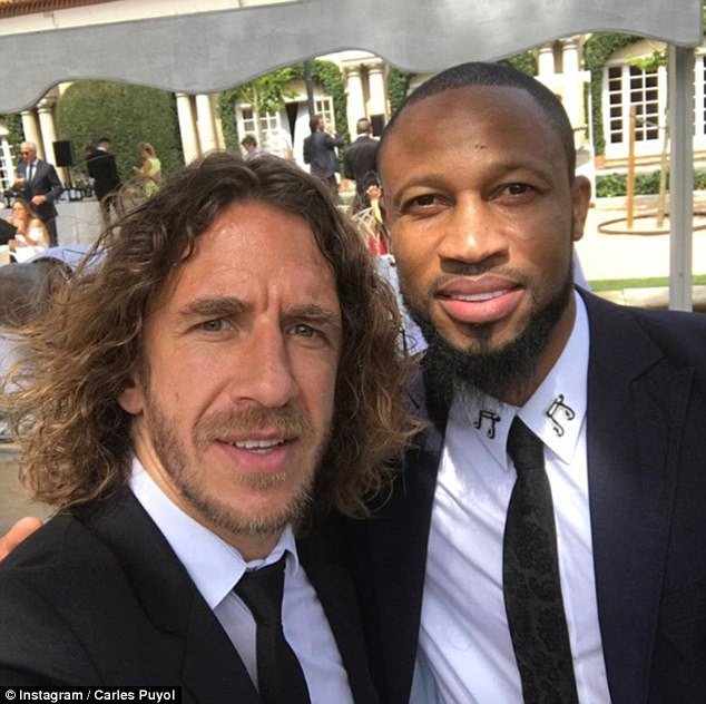Carles Puyol posted a selfie with former team-mate Seydou Keita to his Instagram