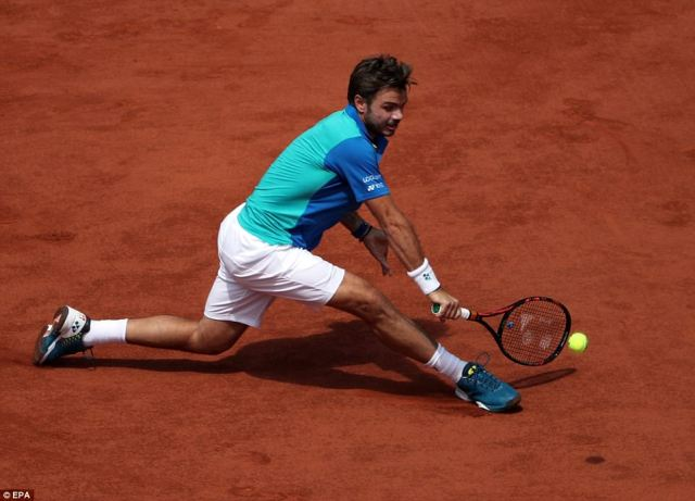 Third seed Wawrinka stretches low to try and reach a backhand, but he was outplayed throughout by the Spanish No 1