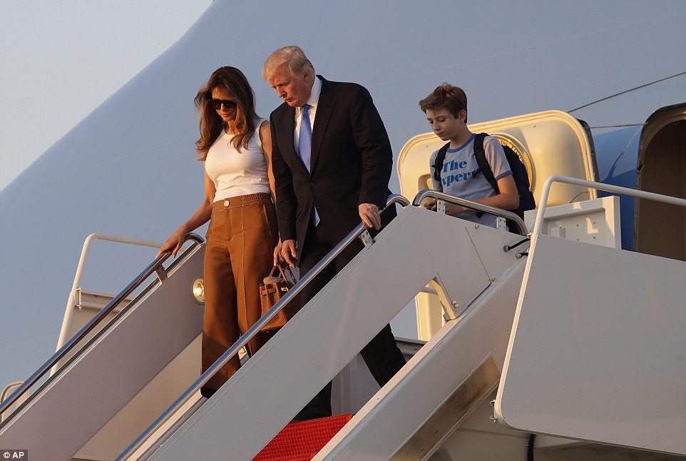 After spending a weekend golfing in New Jersey, the first family arrived back in Washington, DC, with Melania Trump's parents in tow as the First Lady and her 11-year-old son prepare to settle down in the White House full-time - and just in time for the president's birthday. The Trumps are seen stepping off Air Force One on Sunday