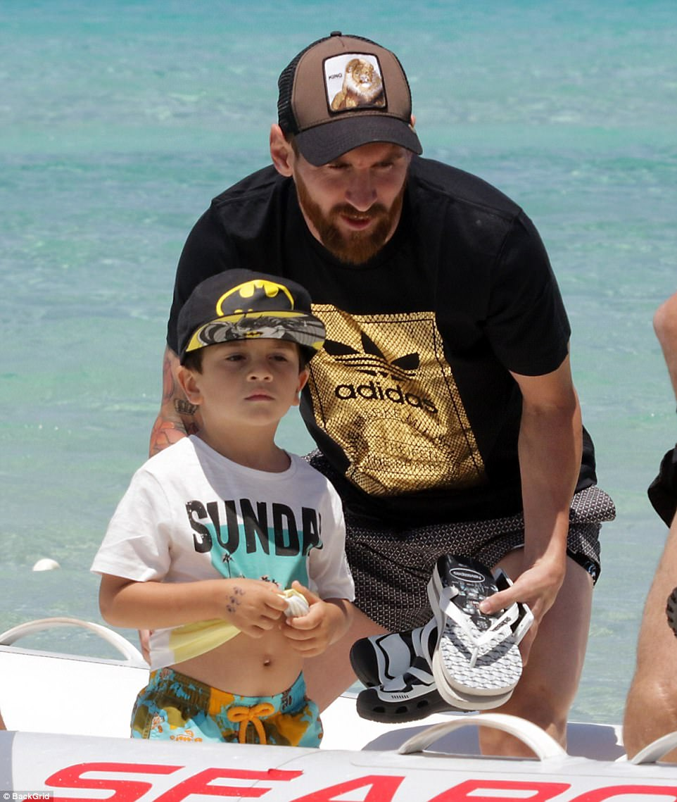Side by side: Messi is taking a pre-season break with his family following a disappointing season with FC Barcelona