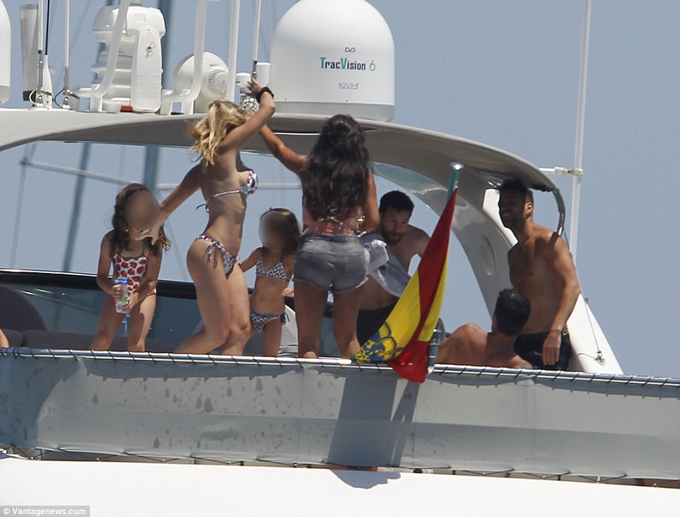 Good times: Cruising across the breathtaking Balearic coastline, the lively group performed an impromptu dance as the three footballers and their assortment of children looked on