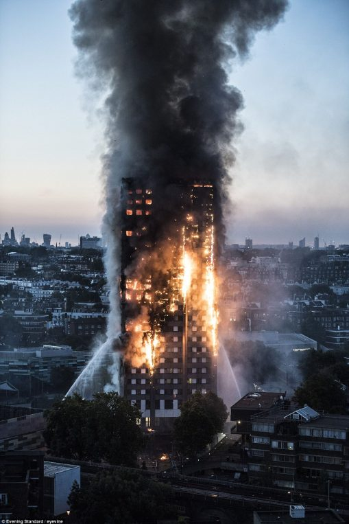 Police would not confirm how many people are unaccounted for because the building is still on fire 14 hours after it started (pictured this morning) - six are known to be dead but the death toll is likely to be significantly much higher