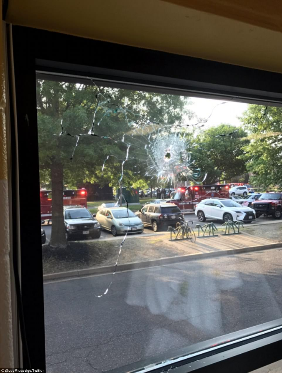 A Twitter user posted this picture of what appeared to be a gunshot hole in a window as he took cover in the YMCA in Alexandria