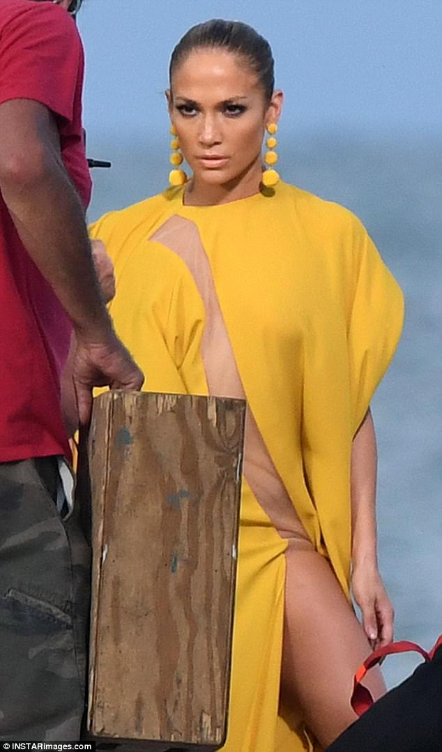No lingerie required: Jennifer Lopez had on no bra, no underwear as she modeled this yellow gown while shooting a music video in Islamorada, Florida