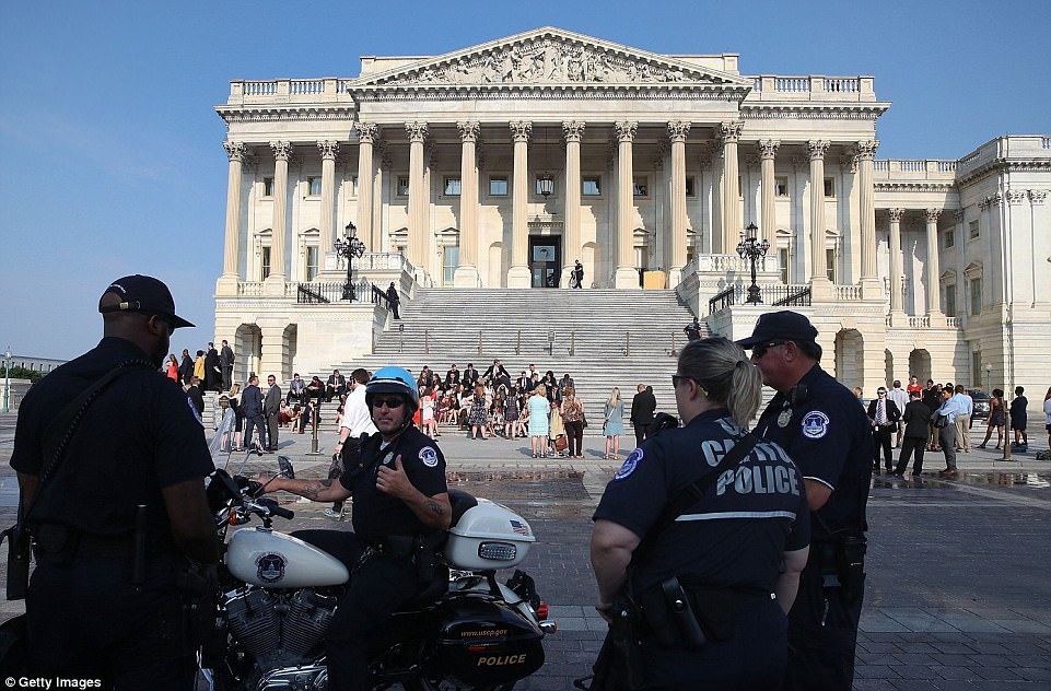 Officers outside the Capitol Building remained alert after the shooting on Wednesday