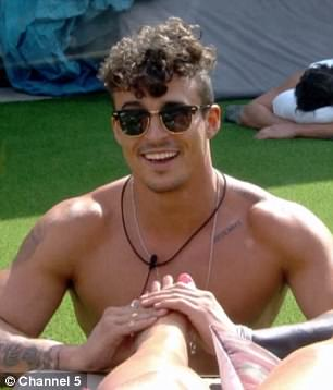 At ease: Making the most of her stay, the TOWIE star welcomed the foot rub from handsome housemate Lotan