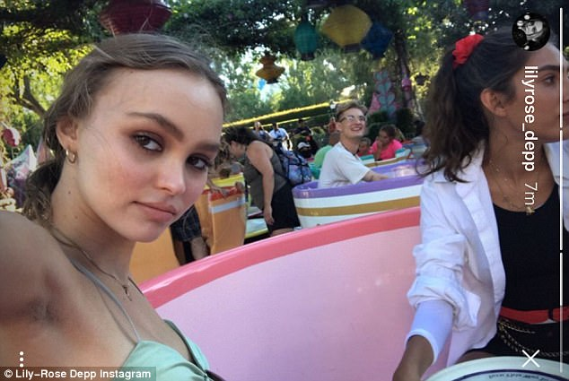 Take a spin: Lily-Rose decided not to smile on the fun Tea Cup ride