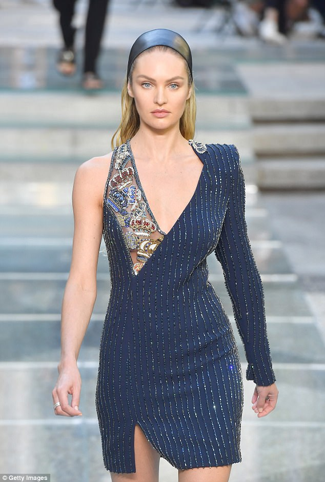 Braless beauty: Candice Swanepoel revealed a little too much under a semi-sheer beaded dress with thigh-split as she walked the runway at Versace in Milan on Saturday