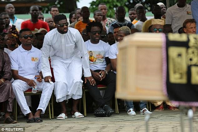 Salomon Kalou and Wilfied Bony flank Kolo Toure as they take their seats for the service