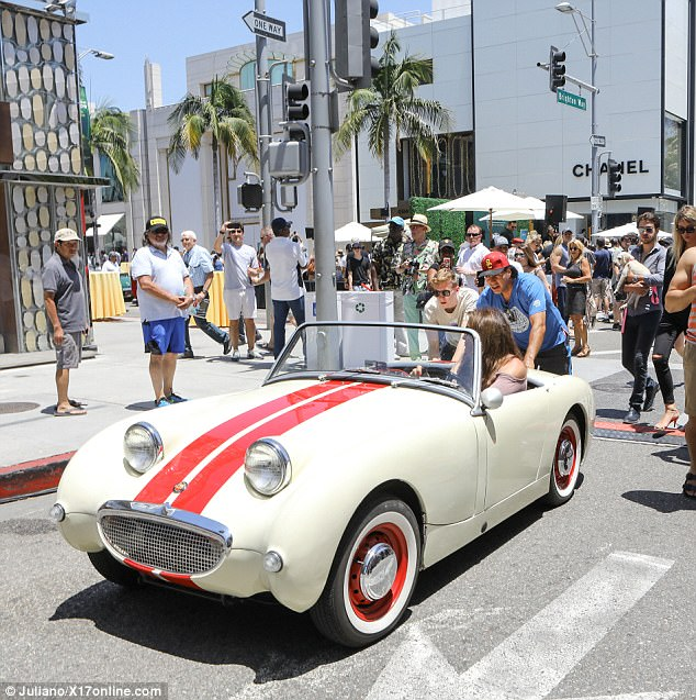 On the go:The Rodeo Drive outpost of Chanel looming behind her, Caitlyn sat in the driver's seat as her vehicle - with assistance - headed along its path up Brighton Way
