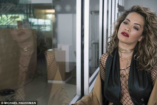 She's very Hot Right Now! Rita's risque get-up teases serious sideboob as she makes her musical return to the spotlight