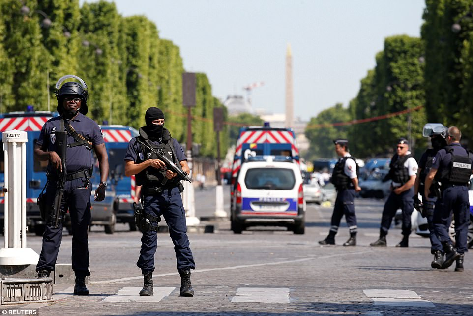 French policemen secure the area on the Champs Elysees avenue after an incident in Paris