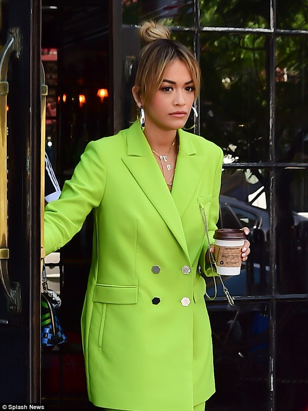 Wouldn't a cool beverage be better? The RIP singer picked up her coffee fix as she made her way out of her New York hotel in the summer's heat