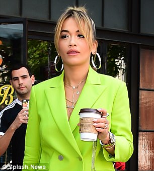 The Hot Right Now hitmaker, 26, ensured she turned heads in a fluorescent trouser suit