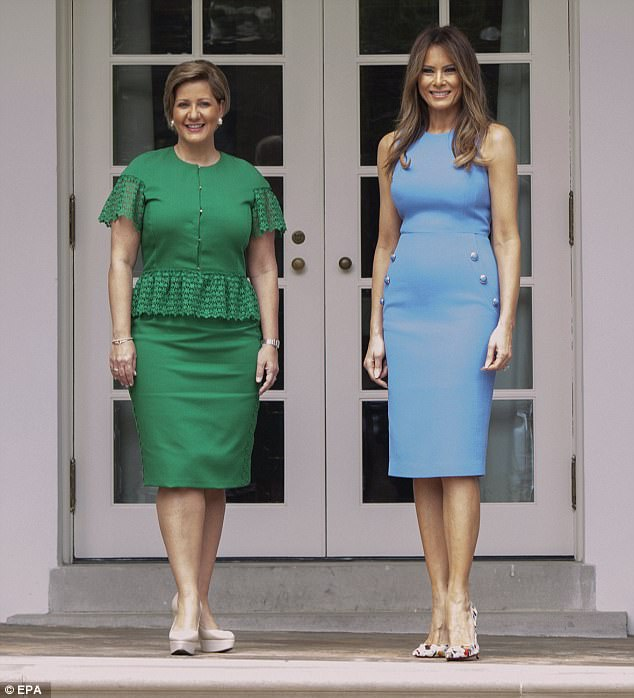 The two first ladies were all smiles as they posed for photos outside the Oval Office