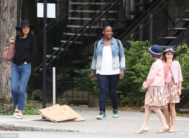 Having some fun:The daughter of Katie and her ex-husband Tom Cruise, Suri looked relaxed and happy as she spent some time in the big city