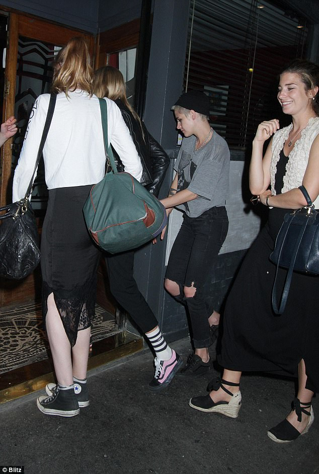 Cute couple: Kristen Stewart and Stella Maxwell, both 27, were pictured hand in hand leaving The Groucho Club in London on Monday night