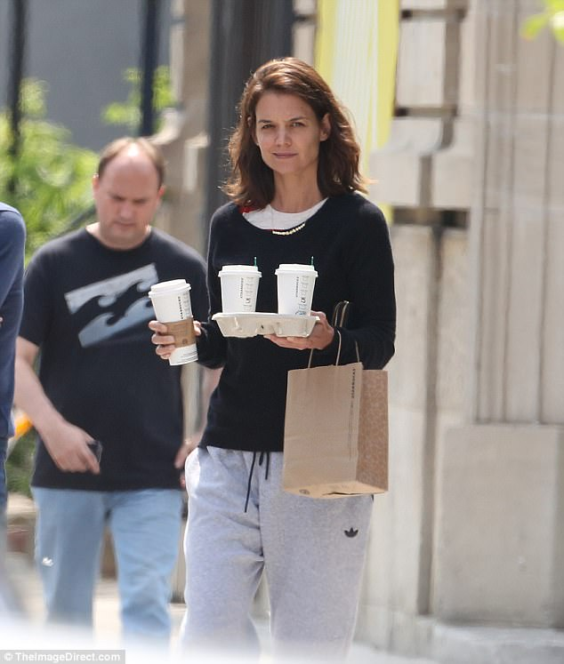 Working hard in the city: Katie Holmes, 38, proved she is down to earth as she made her way to Starbucks in Montreal wearing Adidas sweatpants and a dark sweater