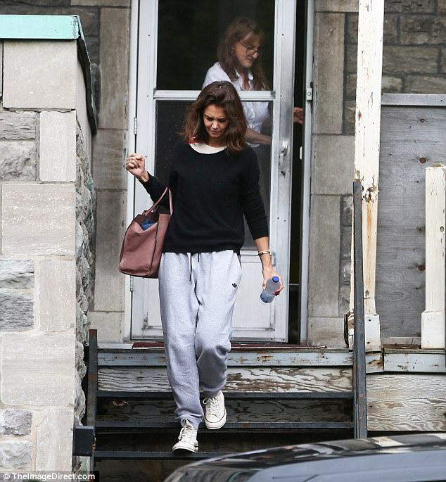 Take two: She was later spotted leaving a porch equipped with her oversized handbag to carry all her belongings and a bottle of water