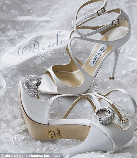 The bride donned a white pair of Jimmy Choo heels embellished with Swarovski crystals and stamped with her initials