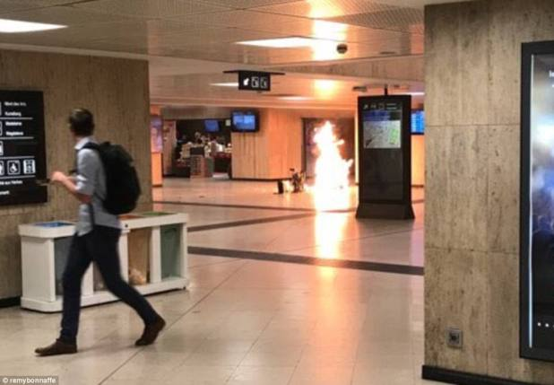 A suspected suicide bomber who allegedly shouted 'Allahu Akbar' before triggering an explosion at Brussels Central Station has been gunned down by soldiers. Pictured the explosion in the station