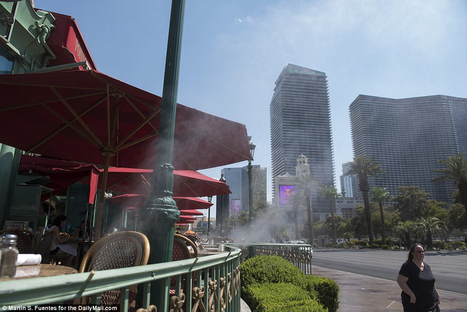 Misters blow out onto near-deserted streets in Las Vegas as a heat wave tied the city's all-time record high temperature
