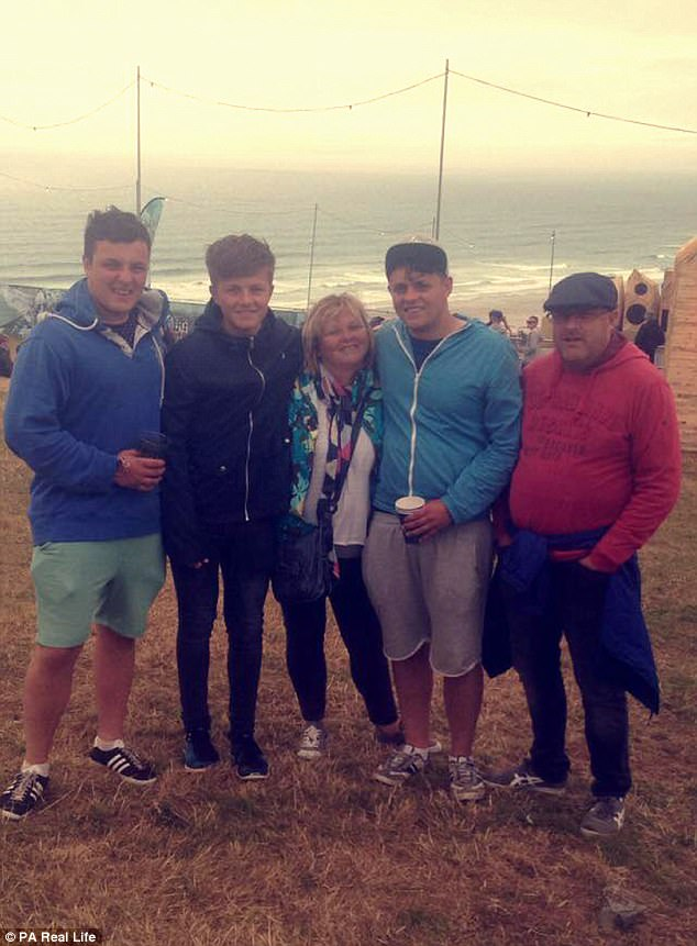 His mother, Jan (centre, with his brothers Joe and Jake and father Gary), said: 'It was horrific to hear what had happened'