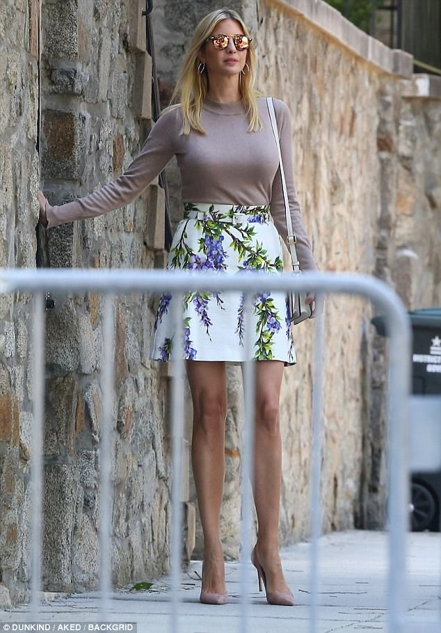 Dressing up: Ivanka was photographed wearing a heavy long-sleep top and a floral skirt as she left her house on Wednesday