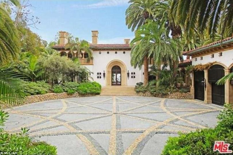 Luxury: The lavish hideaway has extensive 6.3 acre grounds, which contain a rose garden with more than 1,000 flower bushes, a landscaped desert area and a tennis court complete with a viewing deck