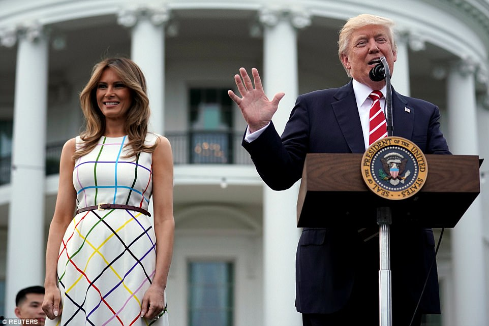 Donald Trump delivers remarks as he hosts a Congressional picnic event, accompanied by First Lady Melania Trump, at the White House
