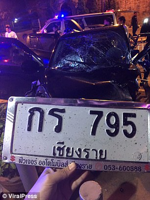 The number plate of the crashed black Suzuki