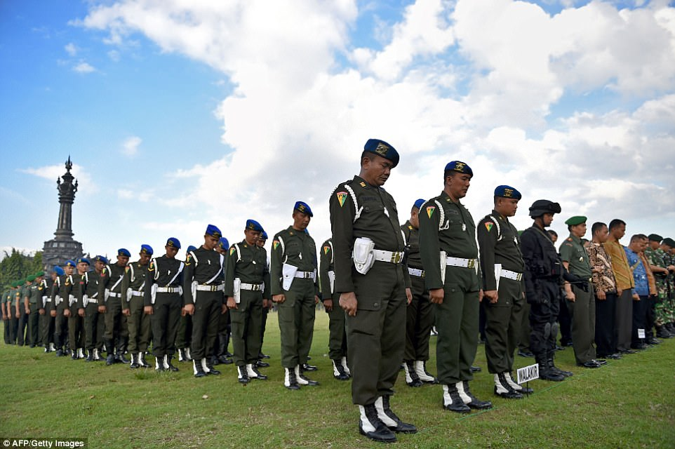 Soldiers fell into formation in Bali, Indonesia, on Friday in preparation for the Obamas' five-day vacation