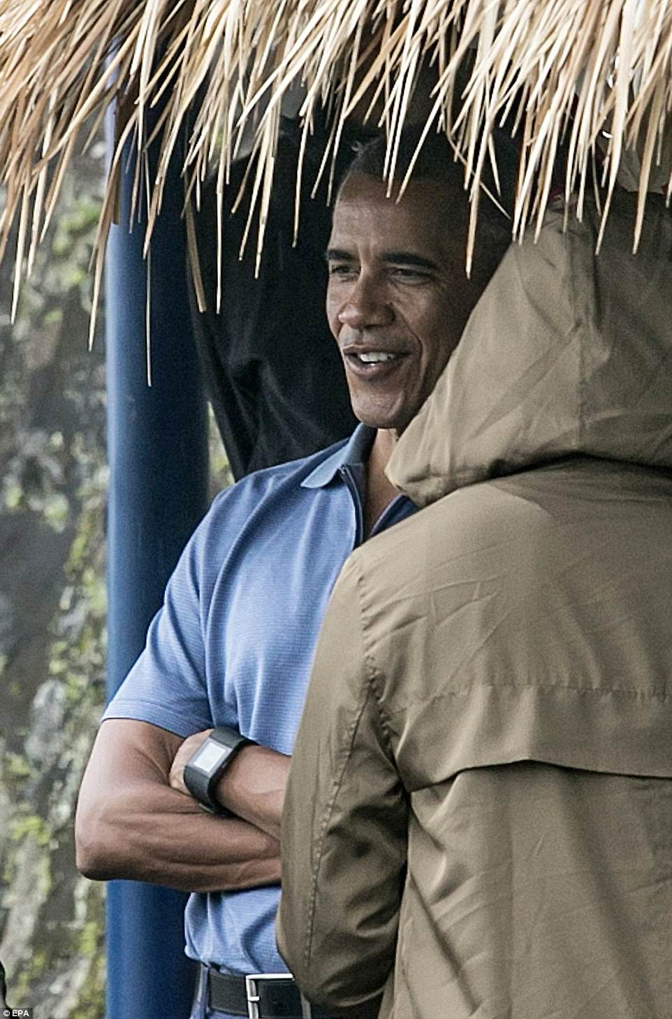 Barack - who used to live in Indonesia in the 1970s - kept things pretty casual in a blue polo top as he looked out over the fields