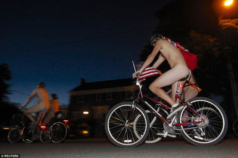 The cover of darkness helps protect the modesty of these riders from the 2014 Portland ride