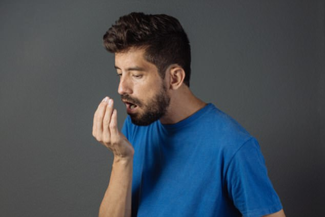 If your breath still smells after brushing your teeth, or if your tongue is covered in a white coating, you may need to look into gut health management (stock image)