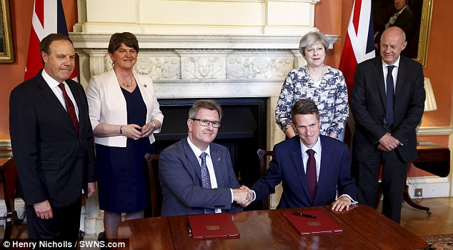 The Tory and DUP chief whips signed the deal in Downing Street as Theresa May and Arlene Foster looked on. Pictured left to right, DUP deputy leader Nigel Dodds, Mrs Foster, DUP chief whip Jeffrey Donaldson, Tory chief whip Gavin Williamson, Mrs May, First Secretary of State Damian Green