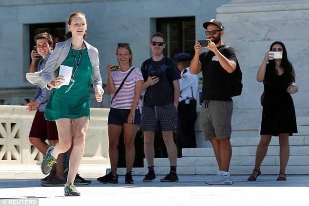 The famed 'running of the interns' was a familiar sight on Monday as young staffers to news agencies hurried to bring written case decisions to their reporters and producers