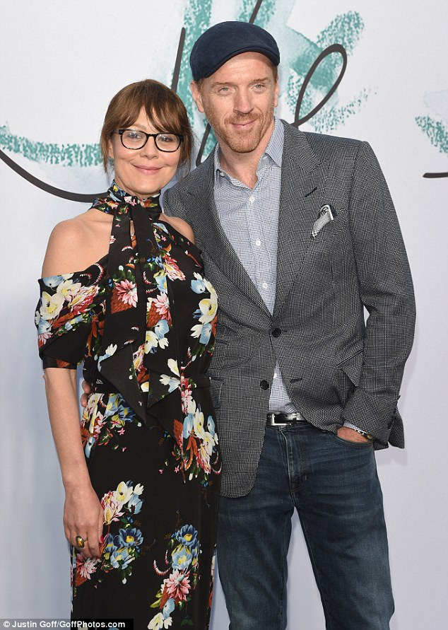 Smitten: Damian Lewis, 46, and his wife Helen McCrory, 48, put on a loved-up display at the Serpentine Gallery Summer Party in London's Kensington Gardens on Wednesday
