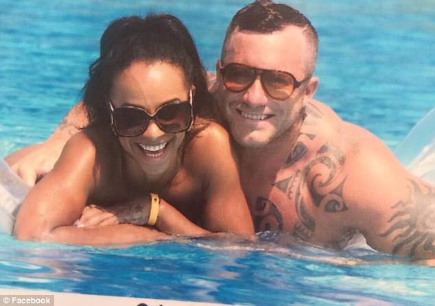 The couple were pictured enjoying themselves in the sea, but a compensation claim alleged Roberts fell ill after just two days